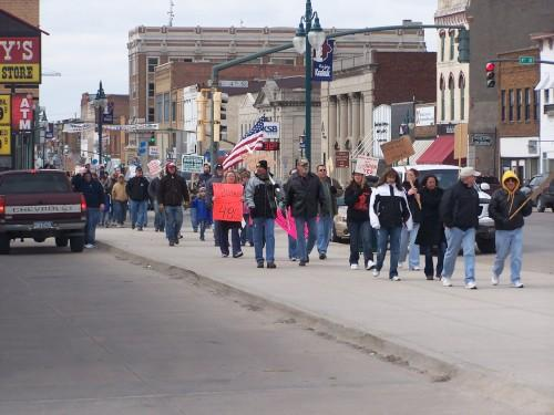 Supporters of Local 48-G complete a lap through downtown Keokuk to show support for workers locked out by Roquette America