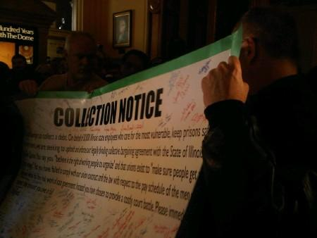 "AFSCME protestors with their ""collection notice"""