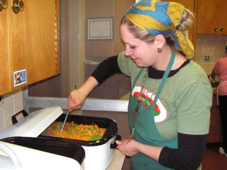 Cook Laura Lytle prepares the vegetables