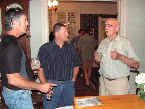 Charlie Miller (right) speaking with former students during the reception