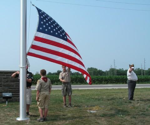 The raising of the American flag during the dedication ceremony