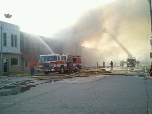 Crews respond to the fire in January that took the life of a young child and destroyed several buildings.