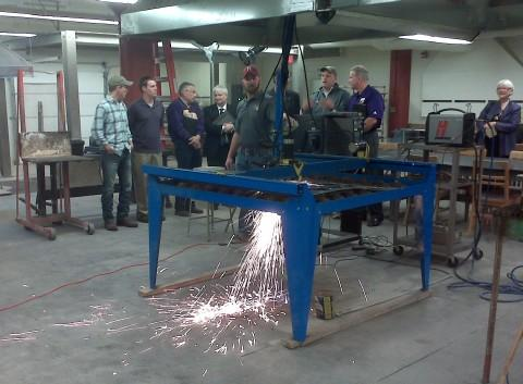 A demonstration of a metal cutting machine in the new 3-D Art Studios