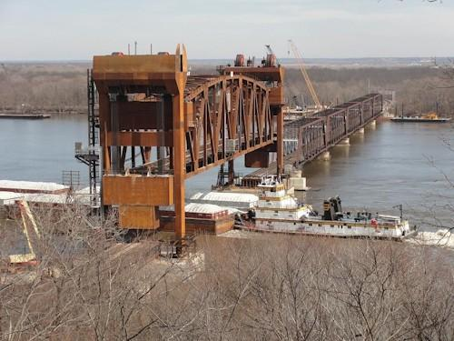 A barge moves through BNSF Railway's new railroad bridge in Burlington, IA