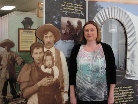 Kim Orth with one of the displays in the Smithsonian Institute's traveling Journey Stories exhibit