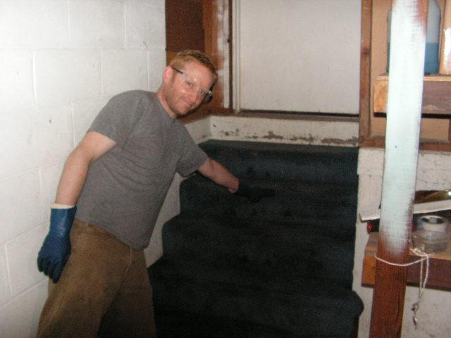 Niall Hartnett showing how high the water was in his basement.