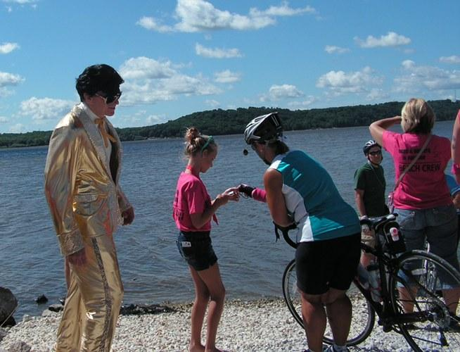 Elvis on hand to help riders dip their tires in the Mississippi River.