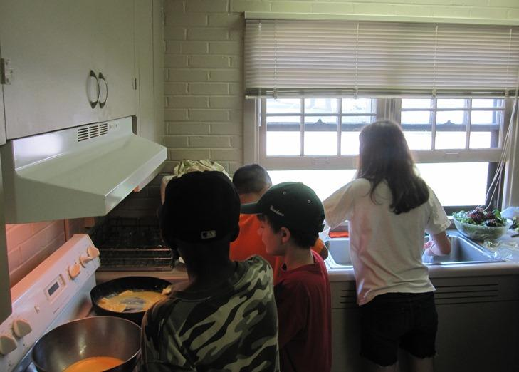 "The ""Farm to Fork"" kids cooking what they harvested."