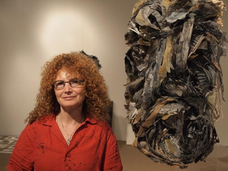Etty Yaniv, standing next to her work