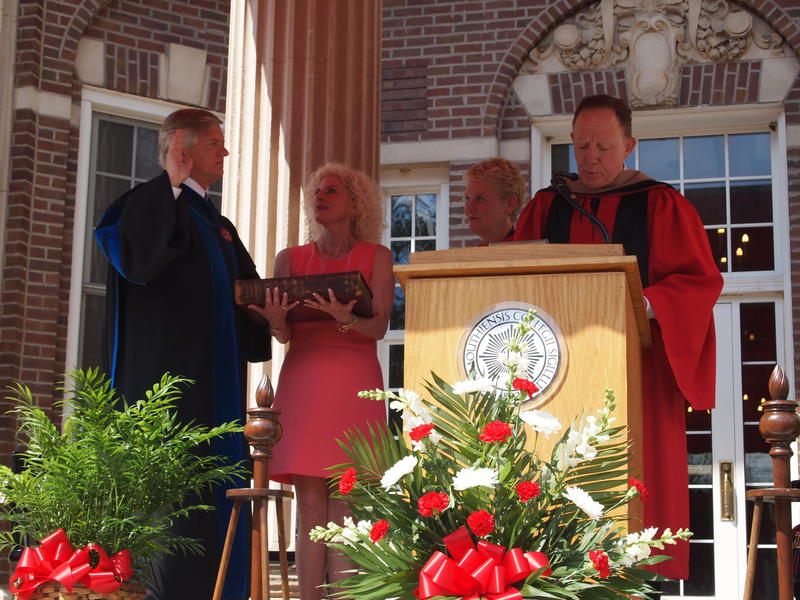 Clarence Wyatt is sworn in as the President of Monmouth College, with First Lady Lobie Stone at his side.