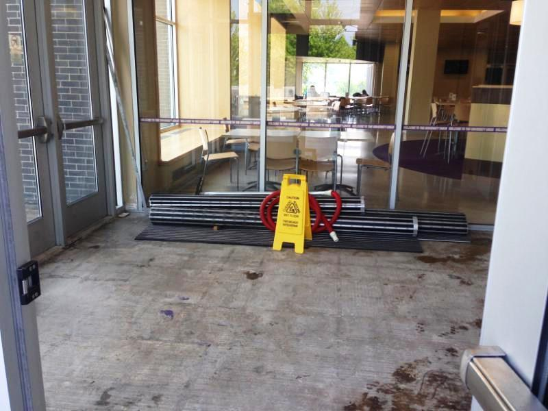 When it rains water soaks in the north union entrance vestibule. It gets under the metal matting and facilities crew have to pull up the mat to suck the water out.