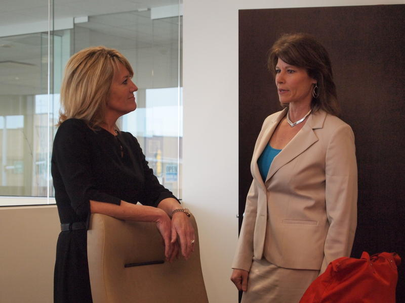 Congresswoman Cheri Bustos (right) talks with Jeannette Klenie of MAK Properties before a meeting with women business leaders in Galesburg.