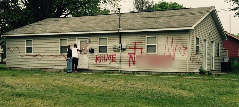 The n-word that was spray painted on the house has been blurred out