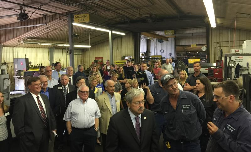 Iowa Gov. Terry Branstad tours Steffensmeier Welding & Manufacturing, which announced plans to build a large solar field.