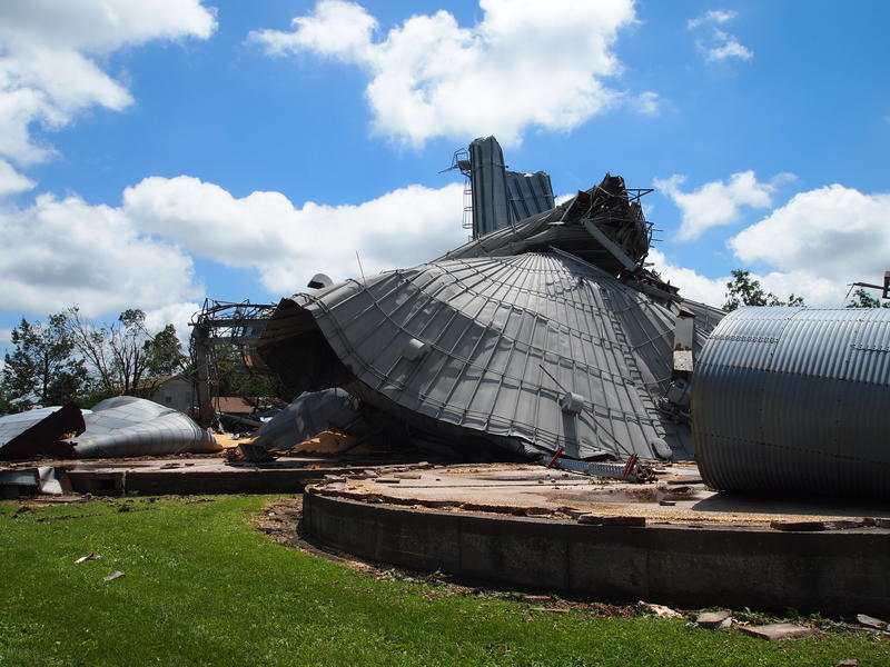 The storm pushed grain bins off their bases and crushed them.