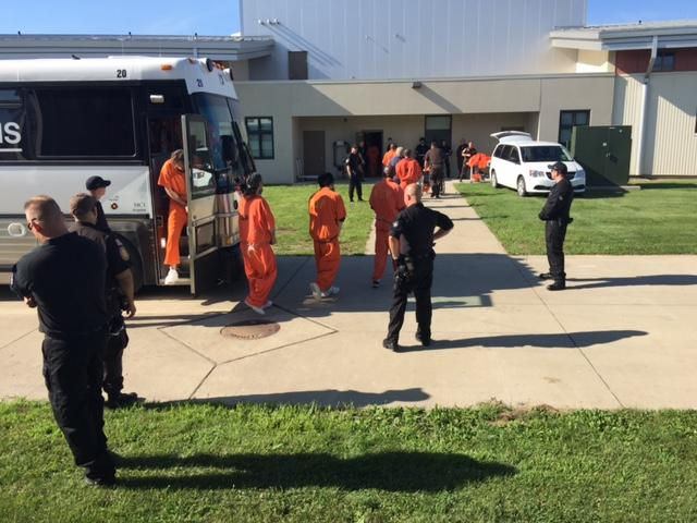 A group of inmates arrives at the new Iowa State Penitentiary