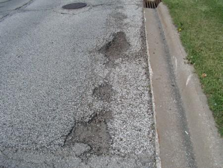 Potholes on a street in Macomb