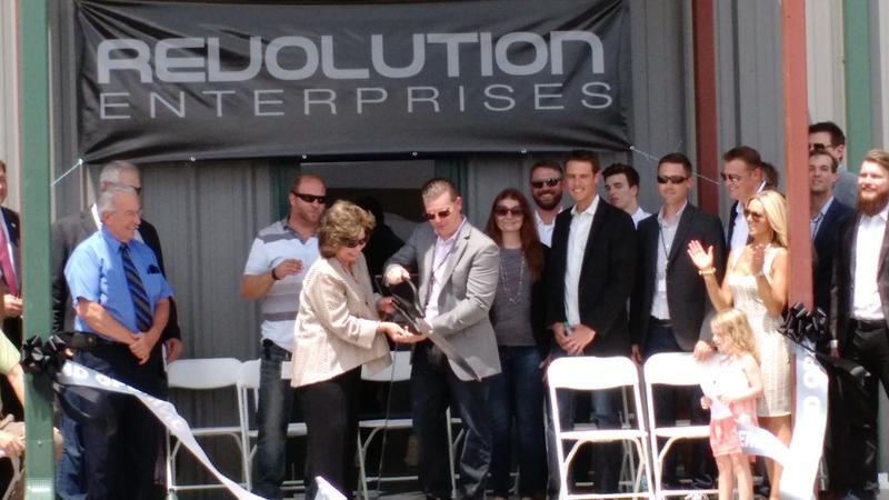 Revolution Enterprise CEO Tim McGraw and Delavan, Illinois Mayor Liz Skinner cut the ribbon at the new medical marijuana cultivation center in Delavan, in late July, 2015.