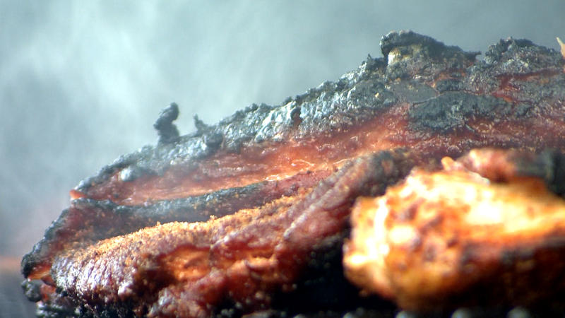 "Ribs and chicken sizzle over charcoal at the ""Ribstock"" barbecue contest in Millard, Neb."