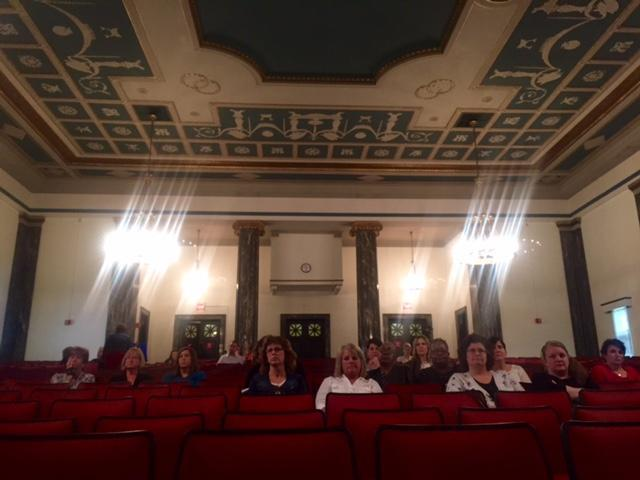 Most of the audience at a legislative hearing on massive cuts to a program that helps students and working parents pay for daycare was mostly comprised of daycare providers and affected mothers; only one legislator was spotted in attendance. All legislato