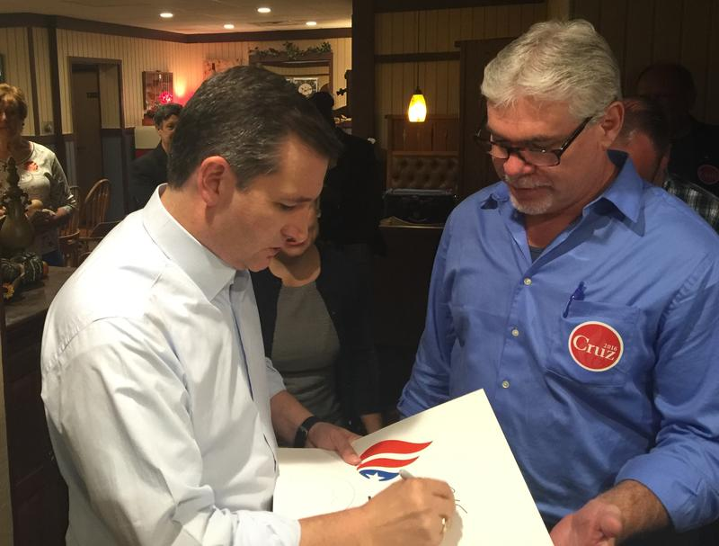 U.S. Senator Ted Cruz (R-Texas) signs an autograph following a campaign stop in Keokuk Tuesday afternoon.