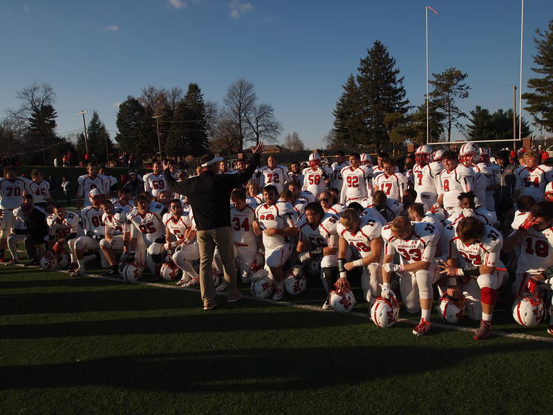 Monmouth head coach Chad Braun talks to his team after the Fighting Scots claimed victory in the 127th Bronze Turkey Game.