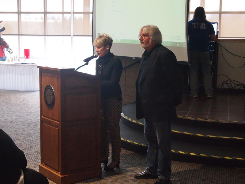 CSC President Lori Sundberg introduces Cuban professor Mario Masvidal to a crowd in the college's Student Center.