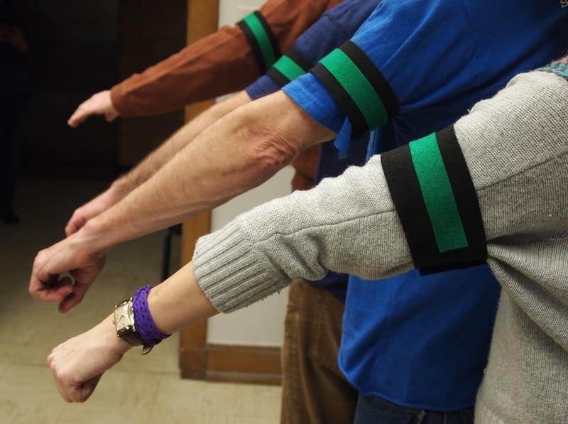 The teachers union hopes faculty and staff will wear black armbands in response to the administration's proposed lay-offs.  The green patch signifies the color used by UPI statewide.