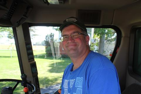 Central Iowa farmer Aaron Lehman, pictured in his combine in 2013, says he asks campaigns specific questions about agricultural issues because they are what will determine who gets his vote.