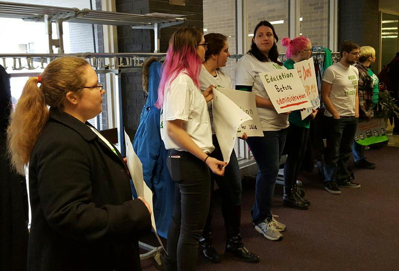 "Some students demonstrated before the BoT meeting. ""I'm supporting the teachers. I don't think any of them should be laid off,"" said junior Sara Lane."