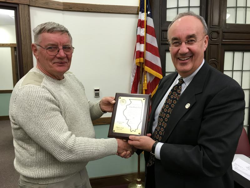 Clay Hinderliter (left) was recognized for his service with a plaque presented by Macomb Mayor Mike Inman (right) during his last city council meeting this week