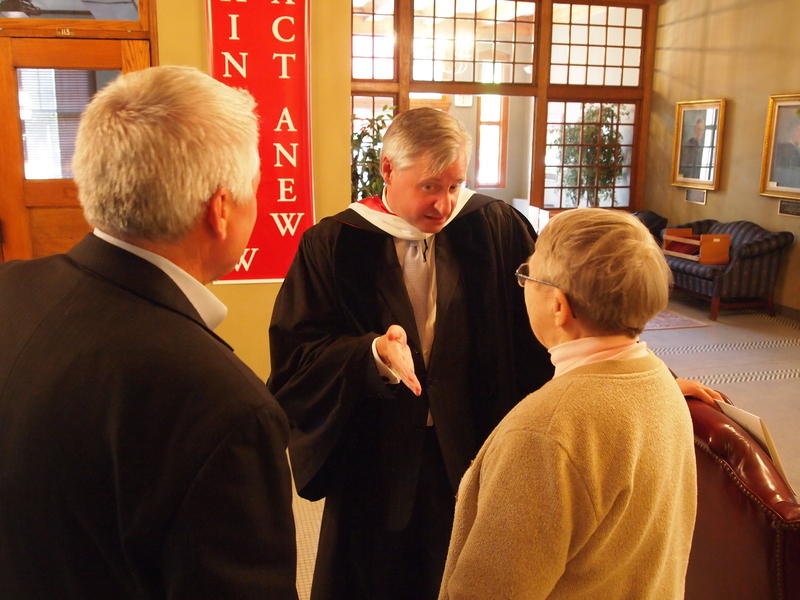 Presidential Historian Jon Meacham talks with people after the Monmouth College commencement ceremony on Sunday.