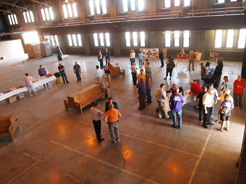 Attendees of the Armory open house mingle and learn more about the facility.