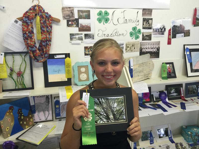 Summer Smith, 15, of Donnellson showing off one of the photographs she entered in the Lee County Fair