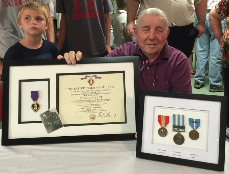 David Harrison of Keokuk poses with his Purple Heart and his three service medals. He was injured in 1950 while serving in the U.S. Army during the Korean War.
