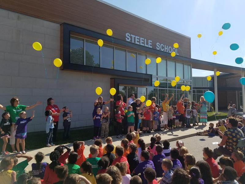 Classmates of Jaden Lester release yellow balloons to the sky to honor the student who passed away last week.  The first grader was six years old.