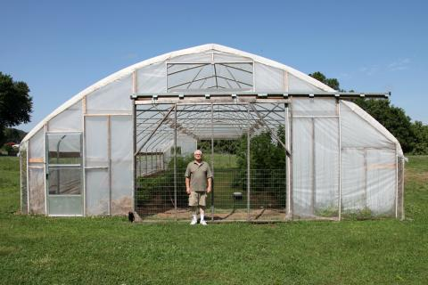 Central Missouri farmer Gary Wenig plants trap crops around his high tunnel in an effort to stop pests from eating his produce.