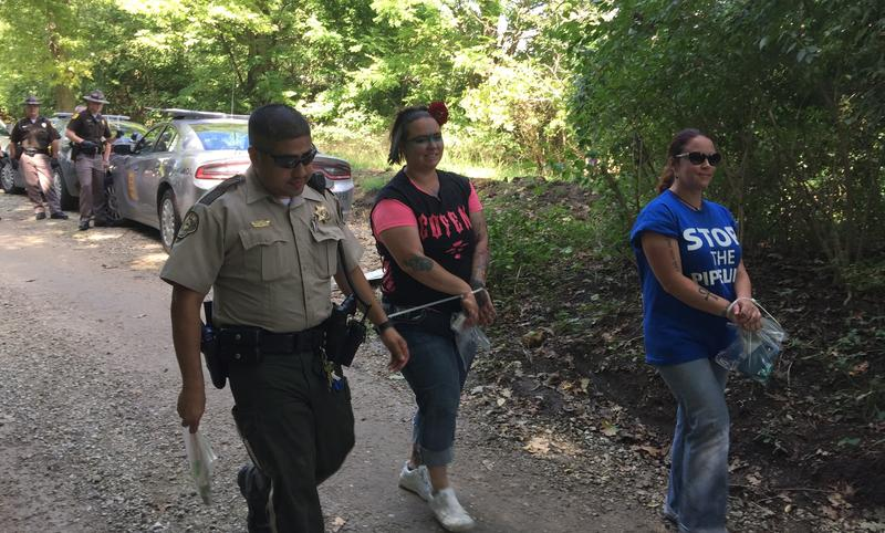 A total of 38 adults and 5 juveniles were arrested and released for trespassing. They all will appear in court in October.