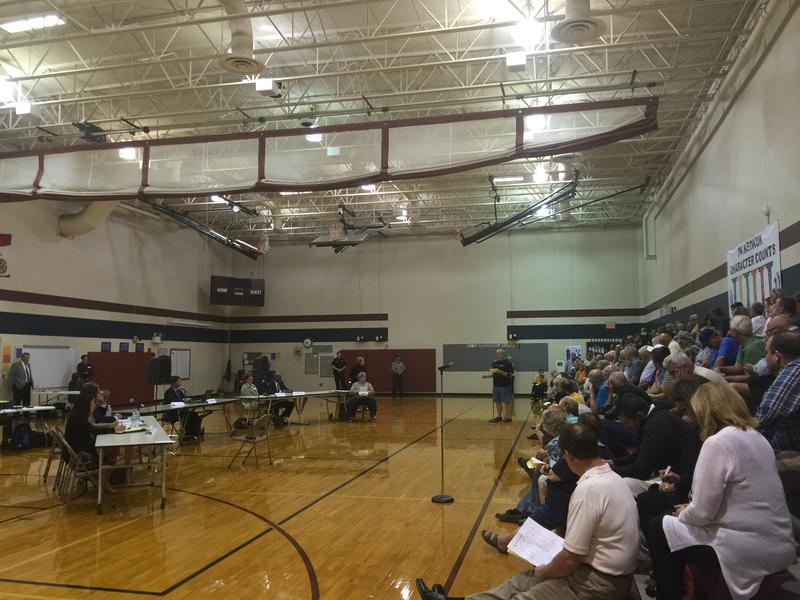 Several hundred people attended an IUB-sponsored public input session in September on a proposed natural gas rate hike.