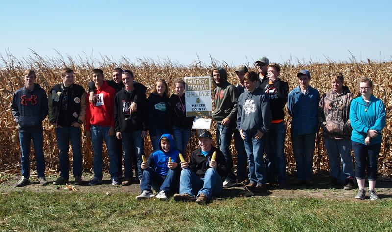 The Mercer County High School class poses for a photo in front of their plot.