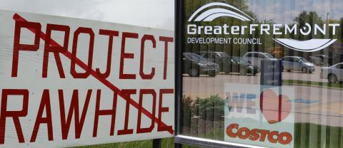 Signs for and against a proposed Costco chicken processing plant, nicknamed Project Rawhide, posted in the town of Fremont in northeast Nebraska.