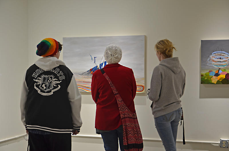 "WIU students enjoying Matt Pulfords exhibition called ""Rain Clearing, Breezy Overnights."""