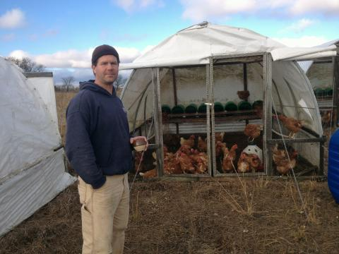 Kansas farmer Phil Holman-Hebert raises hens and sells their eggs for a premium at farmers markets and to restaurants.