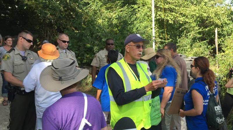 Protesters walked past Lee County Sheriff's deputies last fall as they are told they are trespassing and subject to arrest.