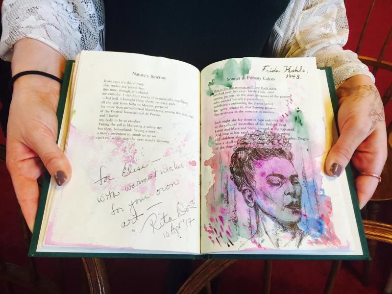 Elise Goitia displays her art in her copy of Rita Dove's poetry collection, Motherly Love.