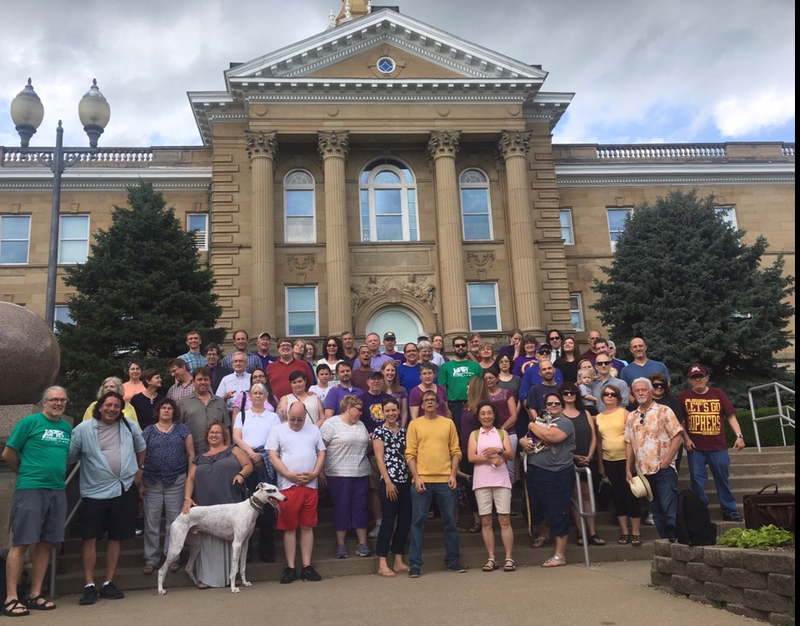Shortly after Unit B received written notice that their contracts were delayed, members and friends of Western's chapter of University Professionals of Illinois took a photo in a show of solidarity in front of Sherman Hall