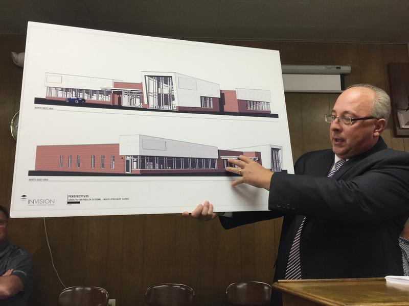 John Mercer holds up a design of what Great River Health Systems' new clniic in Keokuk would look like.