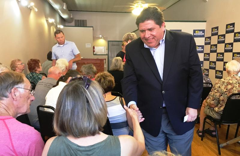 JB Pritzker shakes hands with audience members during his campaign stop in Macomb.