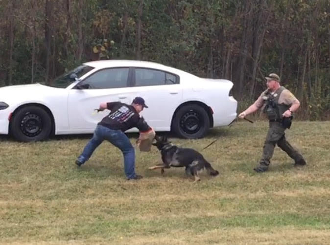 Gunner protecting Dep. Uriah Wheatley (R) from Dep. Jordan Maag, who was coming at Wheatley with a weapon.