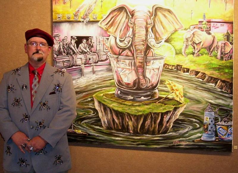 "James Walker Henry, wearing his ""Spiderman"" suit, posed with ""Pink Elephants,"" which is one of his larger paintings on display at the Buchanan Center for the Arts."